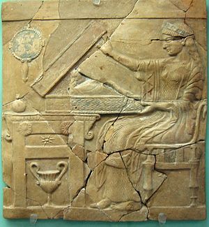 Persephone - Persephone opening a cista containing the infant Adonis, on a pinax from Locri