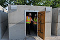 Lucia Gamba, right, Don Braun inspect newly placed storm shelters at the temporary replacement site for Irving Elementary School in Joplin, Mo., July 2, 2011 110702-A-LI404-027.jpg