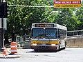 MBTA route 77 bus exiting Harvard Bus Tunnel, July 2015.JPG