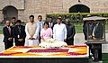 Maithripala Sirisena and Mrs. Jayanthi Sirisena paying homage at the Samadhi of Mahatma Gandhi, at Rajghat, in Delhi. The Minister of State for Road Transport & Highways and Shipping, Shri P. Radhakrishnan is also seen.jpg