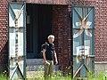 Man in Doorway - Otaru - Hokkaido - Japan (47984528831).jpg