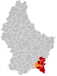 Map of Luxembourg with Dalheim highlighted in orange, the district in dark grey, and the canton in dark red