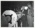 Mark Bortman and two unidentified memebers of the U.S. Air Force inspect an iron lung inside of an aircraft (12619016753).jpg