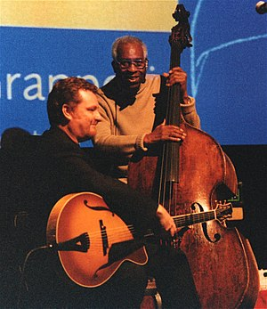 "Martin Taylor (guitarist) - Martin Taylor (left) and Coleridge Goode in London, 2002 at the launch of the Stéphane Grappelli DVD ""A Life in the Jazz Century"""