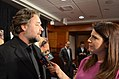 "Mehtap Colak Yilmaz of VOA Turkish, interviewing Russell Crowe on his latest movie ""Water Diviner,"" April 2015.jpg"