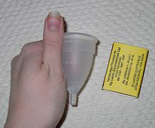 Menstrual cup in hand with a matchbox.jpg