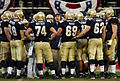 Midshipmen in huddle at 2004 Emerald Bowl 041230-N-9693M-335.jpg