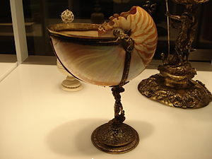 Nautilus shell, mounted on chiselled silver ba...