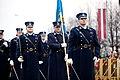 Ministru prezidents Valdis Dombrovskis vēro Nacionālo bruņoto spēku vienību militāro parādi 11.novembra krastmalā (6357773853).jpg