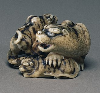 Sculpture - Netsuke of tigress with two cubs, mid-19th century Japan, ivory with shell inlay