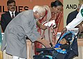 Mohd. Hamid Ansari presenting the National Award for Best Creative Child, Master Rizman Azimuddin Shaikh on the occasion of 'International Day of Disabled Persons' being organized by the Ministry of Social Justice and.jpg