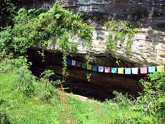 Molaise of Leighlin - Saint Molaise's cave on Holy Isle, Firth of Clyde, decorated with Tibetan Buddhist prayer flags.