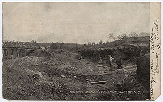 Monazite - Postcard view of a monazite mine in Shelby, North Carolina, showing cart tracks and a bridge