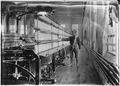 """Mule-spinning room in Chace Cotton Mill. Raoul Julien a """"back-roping boy."""" Has been here 2 years. Burlington, Vt. - NARA - 523189.tif"""