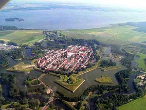 Hollandic Water Line - Aerial view of the fortified town of Naarden; with a good view of the star-shaped layout of the earth bastions, designed in the early gunpowder age to place outward guns to force an enemy to keep distance and thus to protect the town proper against shelling
