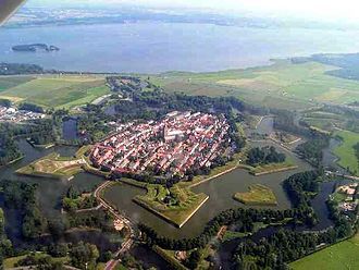 Moat - The 17th-century fortified town of Naarden, Netherlands, showing bastions projecting into the wet moat