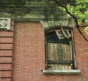 Nam Koo Terrace - Red brickwork on outer wall and window grilles.