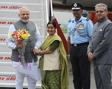 Swaraj with Prime Minister Narendra Modi Narendra Modi being received by the Union Minister for External Affairs and Overseas Indian Affairs, Smt. Sushma Swaraj, on his arrival at Palam airport, after his five days official visit to Japan, in New Delhi.jpg
