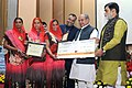 Narendra Singh Tomar conferred the National Awards on Best Performing Women Self-Help Groups and Village Organisations under DAY-NRLM, at a function, in New Delhi (1).jpg