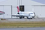 """Network Aviation (VH-NHP) Fokker 100, in new QantasLink """"new roo"""" livery, at Wagga Wagga Airport.jpg"""