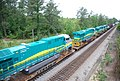 New GE locomotives transported on flat cars for export • 07.jpg