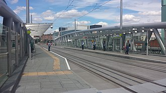 Nottingham station - The Nottingham Station tram stop, showing the former Station Street stop access tower (with NET logo) in the distance