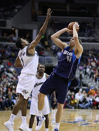 Dirk Nowitzki - Nowitzki shoots his fade-away jump shot in 2008.