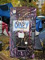 Occupy Portland November 9 vending machine graffiti.jpg