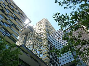 Frasers Property Australia - The pattern of balconies and flash of the cantilevered heliostat in the eastern tower of One Central Park Sydney