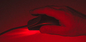 The Logitech iFeel optical mouse uses a red LE...