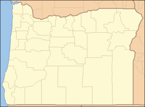 A map of Oregon with a red dot in the southwest