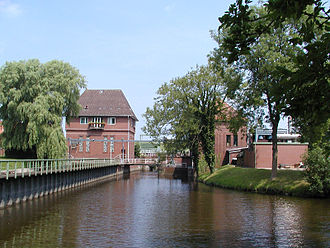 "Land Hadeln - The Otterndorf Sluice and its pumping station. Right: the ""diesel"" pumphouse (nowadays also driven by an electric engine), left: the electric pumphouse."