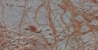 Tholin - Intricate pattern of linear fractures on Europa's surface, likely colored by tholins