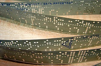 Computer program - In the 1950s, computer programs were stored on perforated paper tape