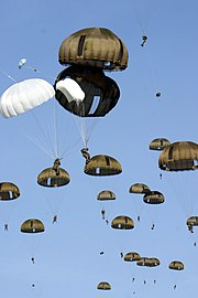Paratroopers of the 2e REP. Two of the soldiers had problems and opened their reserve.