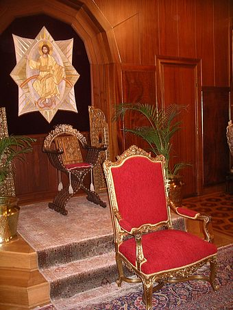 Throne of the Ecumenical Patriarch of Constantinople in the Phanar, Istanbul. On the dais the Gospel is enthroned on a curule chair, in front of it, lower down is the patriarch's throne. Patriarch of Constantinople throne.jpg