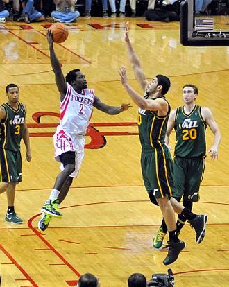 Patrick Beverley - Beverley with the Rockets in March 2014, going up for a shot against Enes Kanter