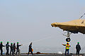 Personnel load a U.S. Navy X-47B Unmanned Combat Air System demonstrator aircraft onto the flight deck of the aircraft carrier USS George H.W. Bush (CVN 77) in Norfolk, Va., May 6, 2013 130506-N-CZ979-075.jpg