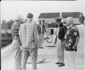 Photograph of President Truman chatting with members of his official party who have just returned from a fishing... - NARA - 200570.tif