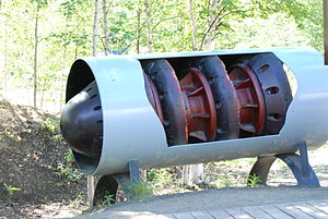 Pigging - A pig on display in a section of cutaway pipe, from the Alaska Pipeline