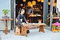 Playing the Japanese stringed musical instrument Koto in Berlin (33947845808).jpg