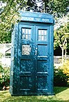 The TARDIS in its typical blue police box disguise