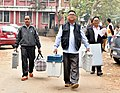 Polling officials carrying the Electronic Voting Machines (EVMs) and other necessary inputs required for the Nagaland Assembly Election, at a distribution centre, in Dimapur on February 26, 2018.jpg