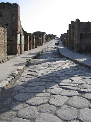 Curb - Curbs and raised sidewalks beside a 2000-year-old paved road, Pompeii, Italy