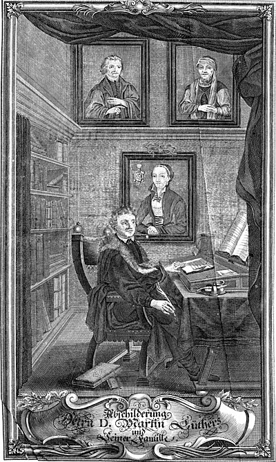 Martin Luther at his desk with family portraits (17th century) Portrait of Martin Luther at his Desk.jpg