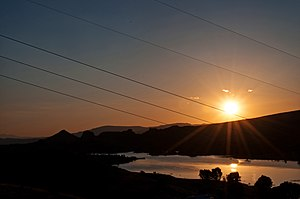 Power lines crossing sunrise at Watson Lake.
