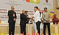 """Pranab Mukherjee presenting the Rajat Kamal Award for Best Investigative Film """"Phum Shang"""", in Non Feature Films Section to the Director, Shri Haobam Paban Kumar, at the 62nd National Film Awards Function.jpg"""