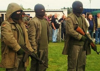 Active service unit - An example of an active service unit at a 1981 hunger strikes commemoration in Galbally, County Tyrone, 2009, as part of a re-enactment. The weapons are a Beretta AR70, a MAC-10 machine pistol (with sound suppressor) and an AK-47 assault rifle.