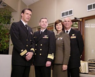 "JAG (TV series) - The then-Judge Advocate General of the Navy, Rear Admiral Donald J. Guter, visiting the set, meeting with the cast during the shooting of ""Liberty"" in 2001"