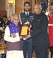 Ram Nath Kovind presenting the Sangeet Natak Akademi's Fellowships (Akademi Ratna) and Sangeet Natak Akademi Awards (Akademi Puraskar) for the year 2016, at the investiture ceremony, at Rashtrapati Bhavan, in New Delhi (5).jpg